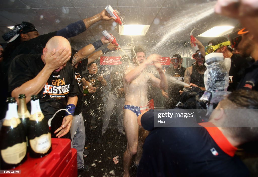 Josh Reddick #22 of the Houston Astros celebrates with teammates in the clubhouse after defeating the Boston Red Sox 5-4 in game four of the American League Division Series at Fenway Park on October 9, 2017 in Boston, Massachusetts. The Astros advance to the American League Championship Series.
