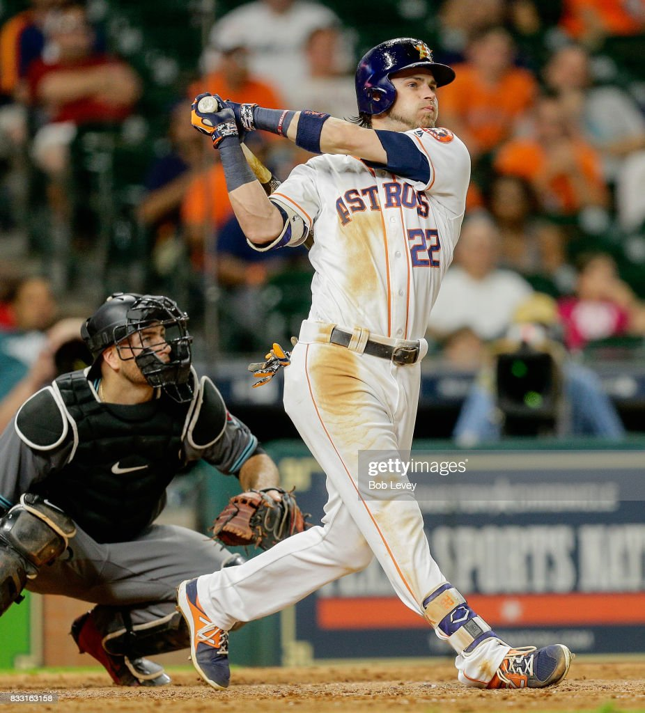 Josh Reddick #22 of the Houston Astros hits a two-run home run in the eighth inning against the Arizona Diamondbacks at Minute Maid Park on August 16, 2017 in Houston, Texas.