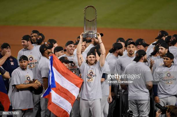 Josh Reddick of the Houston Astros holds the Commissioner's Trophy after defeating the Los Angeles Dodgers 51 in game seven to win the 2017 World...