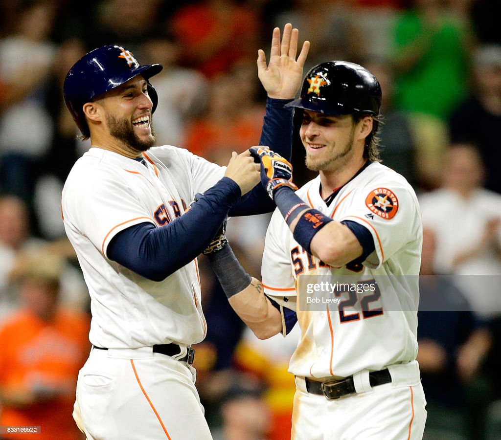 Josh Reddick #22 of the Houston Astros is congratulated from George Springer #4 after hitting a two-run home run in the eighth inning against the Arizona Diamondbacks at Minute Maid Park on August 16, 2017 in Houston, Texas.