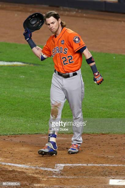 Josh Reddick of the Houston Astros reacts after striking out to end the top of the fifth inning against Masahiro Tanaka of the New York Yankees in...