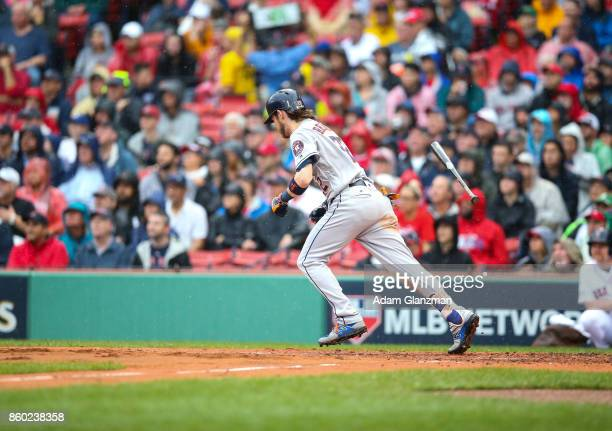 Josh Reddick of the Houston Astros singles in the second inning of Game 4 of the American League Division Series against the Boston Red Sox at Fenway...