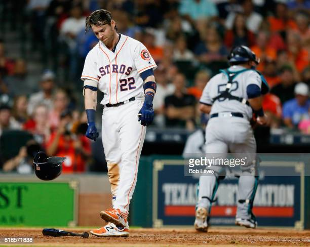 Josh Reddick of the Houston Astros throws his helmet down after striking out on a foul tip in the seventh inning against the Seattle Mariners at...