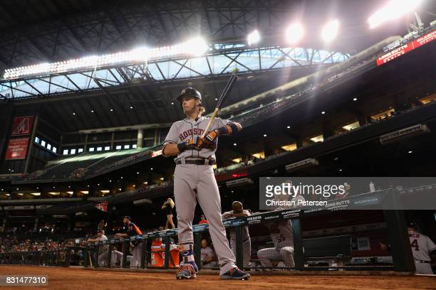 Josh Reddick of the Houston Astros warms up on deck during the first inning of the MLB game against the Arizona Diamondbacks at Chase Field on August...