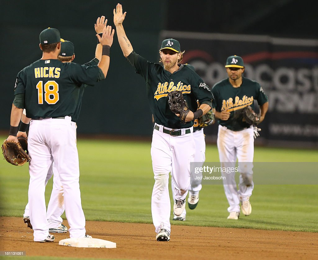<a gi-track='captionPersonalityLinkClicked' href=/galleries/search?phrase=Josh+Reddick&family=editorial&specificpeople=5746348 ng-click='$event.stopPropagation()'>Josh Reddick</a> #16 of the Oakland Athletics celebrates after defeating the Boston Red Sox during a Major League Baseball game at the O.co Coliseum on September 1, 2012 in Oakland, California.