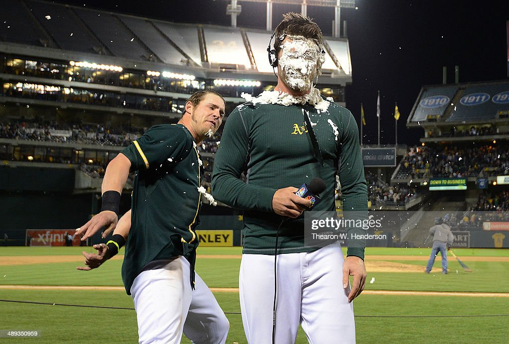 <a gi-track='captionPersonalityLinkClicked' href=/galleries/search?phrase=Josh+Reddick&family=editorial&specificpeople=5746348 ng-click='$event.stopPropagation()'>Josh Reddick</a> #16 of the Oakland Athletics celebrates by hitting <a gi-track='captionPersonalityLinkClicked' href=/galleries/search?phrase=John+Jaso&family=editorial&specificpeople=4951282 ng-click='$event.stopPropagation()'>John Jaso</a> #5 in the face with a pie after Jaso hit a walk-off RBI double scoring Nick Punto #1 to defeat the Washington Nationals in the bottom of the tenth inning 4-3 at O.co Coliseum on May 10, 2014 in Oakland, California.