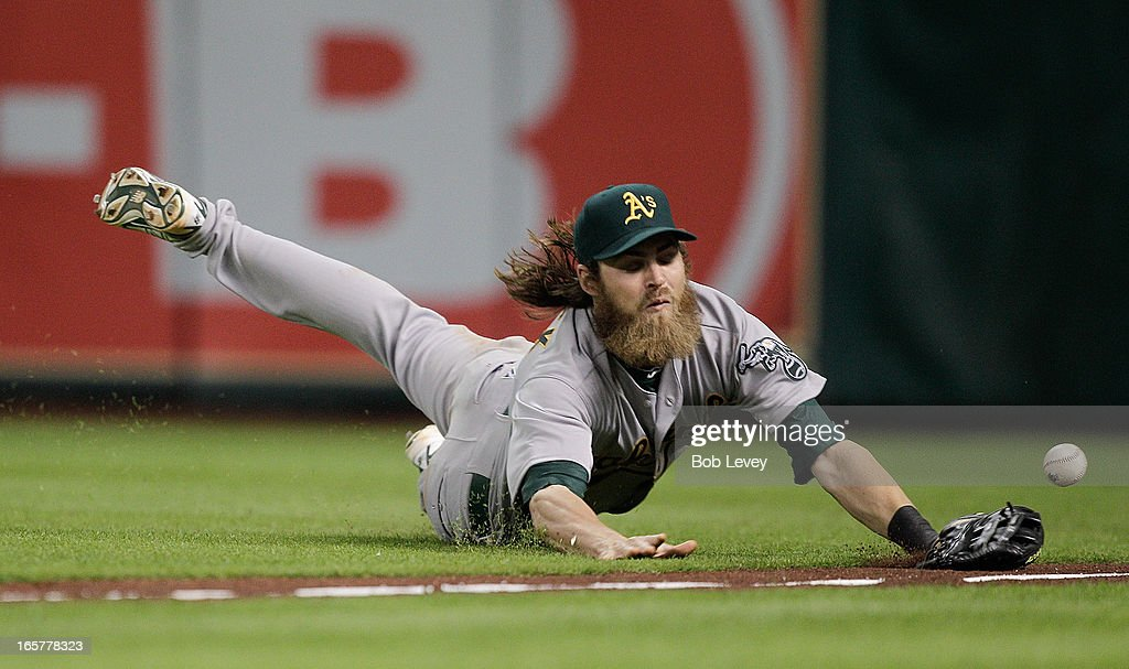 <a gi-track='captionPersonalityLinkClicked' href=/galleries/search?phrase=Josh+Reddick&family=editorial&specificpeople=5746348 ng-click='$event.stopPropagation()'>Josh Reddick</a> #16 of the Oakland Athletics dives but can't make a catch on shallow fly ball down the line hit by Matt Dominguez #30 of the Houston Astros in the ninth inning at Minute Maid Park on April 5, 2013 in Houston, Texas.