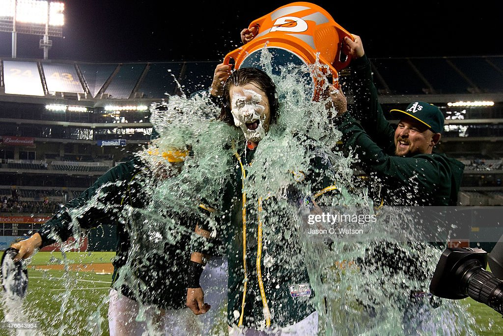 <a gi-track='captionPersonalityLinkClicked' href=/galleries/search?phrase=Josh+Reddick&family=editorial&specificpeople=5746348 ng-click='$event.stopPropagation()'>Josh Reddick</a> #22 of the Oakland Athletics has Gatorade poured on him by <a gi-track='captionPersonalityLinkClicked' href=/galleries/search?phrase=Billy+Butler&family=editorial&specificpeople=759092 ng-click='$event.stopPropagation()'>Billy Butler</a> #16 and <a gi-track='captionPersonalityLinkClicked' href=/galleries/search?phrase=Stephen+Vogt&family=editorial&specificpeople=7511888 ng-click='$event.stopPropagation()'>Stephen Vogt</a> #21 after hitting a walk off RBI against the Texas Rangers at O.co Coliseum on June 10, 2015 in Oakland, California. The Oakland Athletics defeated the Texas Rangers 5-4.