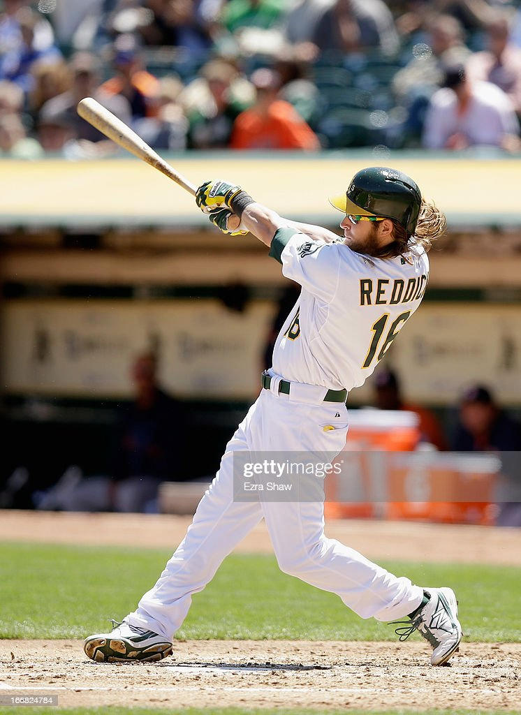 Josh Reddick #16 of the Oakland Athletics hits a double to score two runs in the first inning of their game against the Houston Astros at O.co Coliseum on April 17, 2013 in Oakland, California.