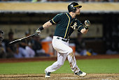 Josh Reddick of the Oakland Athletics hits a tworun homer against the Chicago White Sox in the bottom of the fifth inning at Oco Coliseum on May 13...