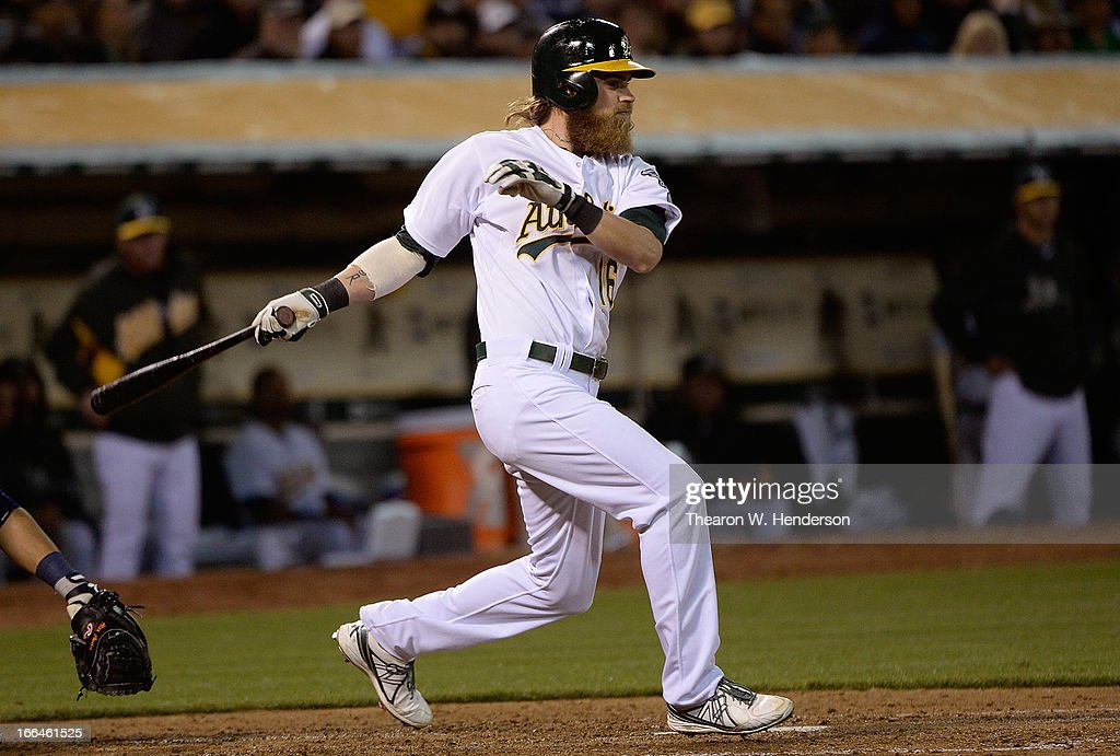 <a gi-track='captionPersonalityLinkClicked' href=/galleries/search?phrase=Josh+Reddick&family=editorial&specificpeople=5746348 ng-click='$event.stopPropagation()'>Josh Reddick</a> #16 of the Oakland Athletics hits an RBI single driving in teammate Jed Lowrie #8 against the Detroit Tigers in the bottom of the six inning at O.co Coliseum on April 12, 2013 in Oakland, California.