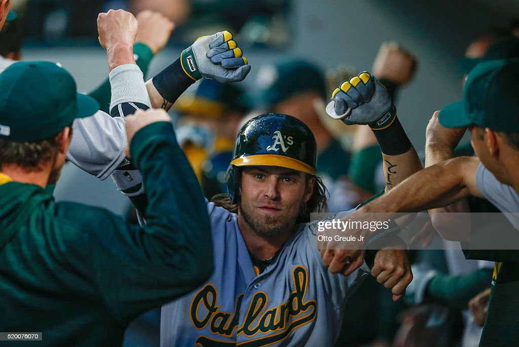 <a gi-track='captionPersonalityLinkClicked' href=/galleries/search?phrase=Josh+Reddick&family=editorial&specificpeople=5746348 ng-click='$event.stopPropagation()'>Josh Reddick</a> #22 of the Oakland Athletics is congratulated by teammates after hitting a two-run home run in the fifth inning against the Seattle Mariners at Safeco Field on April 9, 2016 in Seattle, Washington.