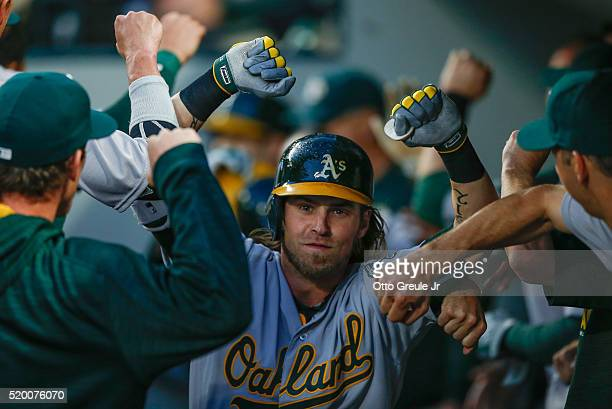 Josh Reddick of the Oakland Athletics is congratulated by teammates after hitting a tworun home run in the fifth inning against the Seattle Mariners...
