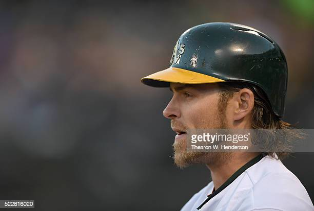 Josh Reddick of the Oakland Athletics looks on from the ondeck circle against the Kansas City Royals in the bottom of the first inning at Oco...