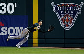 Josh Reddick of the Oakland Athletics makes a diving catch in on a fly out hit by Austin Jackson of the Detroit Tigers during Game One of the...