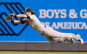 Josh Reddick of the Oakland Athletics makes a diving catch in right field on a ball off the bat of Brian Dozier of the Minnesota Twins in the fifth...
