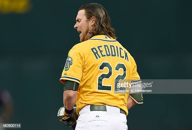 Josh Reddick of the Oakland Athletics reacts after he flew out to centerfield for the final out of the third inning against the Cleveland Indians at...