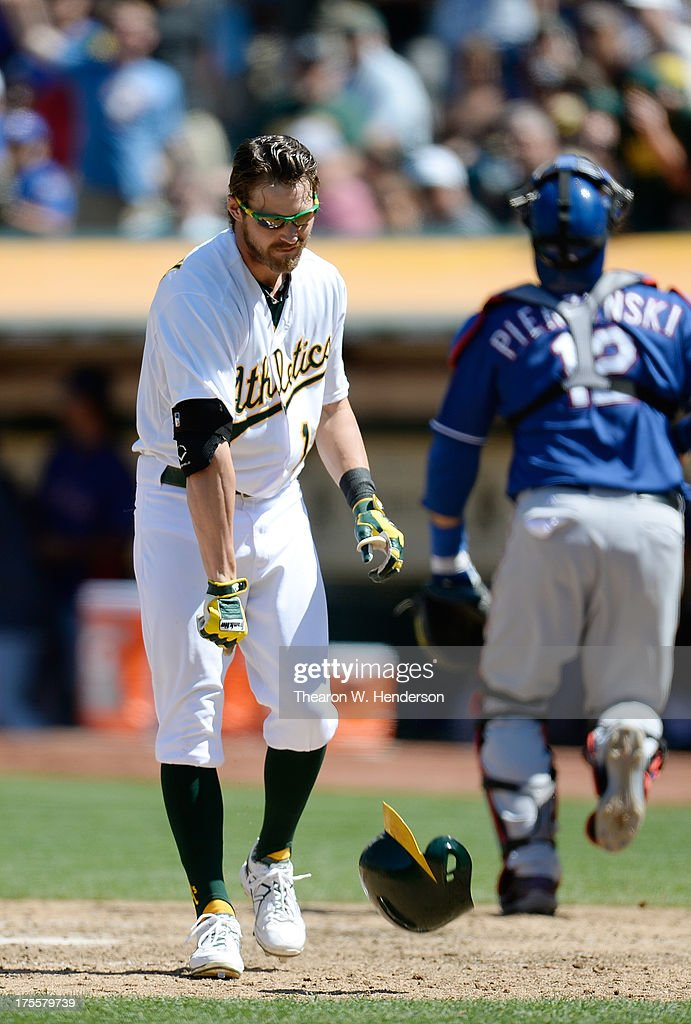 <a gi-track='captionPersonalityLinkClicked' href=/galleries/search?phrase=Josh+Reddick&family=editorial&specificpeople=5746348 ng-click='$event.stopPropagation()'>Josh Reddick</a> #16 of the Oakland Athletics reacts and slams his helmet to the ground after striking out for the third out of the seventh inning against the Texas Rangers at O.co Coliseum on August 4, 2013 in Oakland, California.