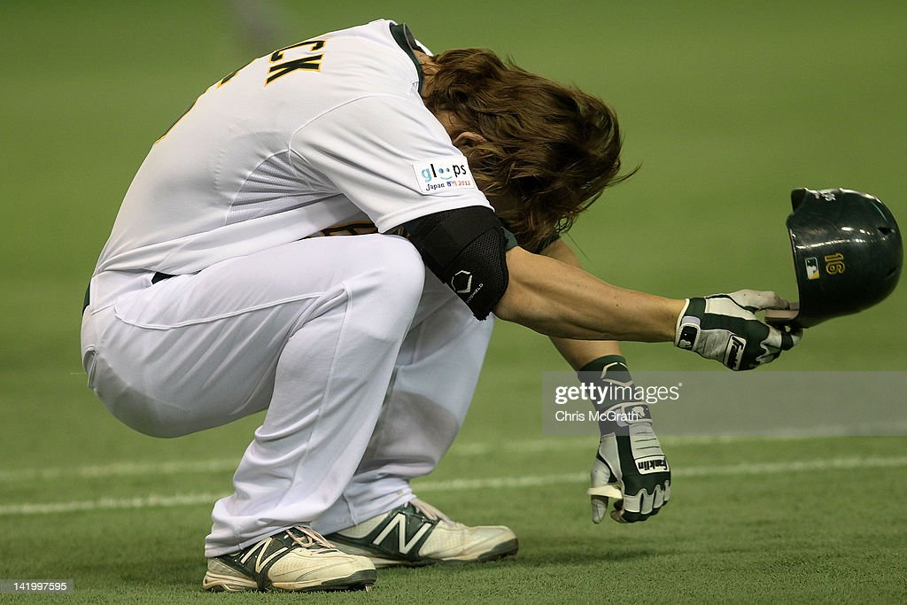 Josh Reddick #16 of the Oakland Athletics reacts to getting out in the sixth innings against the Seattle Mariners during the MLB Opening Series game between the Seattle Mariners and Oakland Athletics at Tokyo Dome on March 28, 2012 in Tokyo, Japan.