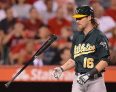 Josh Reddick of the Oakland Athletics reacts to his strikeout against the Los Angeles Angels during the fifth inning at Angel Stadium of Anaheim on...