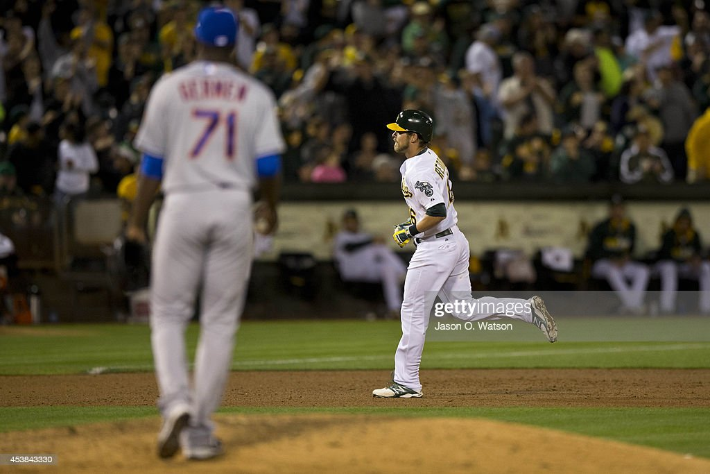 <a gi-track='captionPersonalityLinkClicked' href=/galleries/search?phrase=Josh+Reddick&family=editorial&specificpeople=5746348 ng-click='$event.stopPropagation()'>Josh Reddick</a> #16 of the Oakland Athletics rounds the bases after hitting a two run home run off of Gonzalez Germen #71 of the New York Mets during the eighth inning of an interleague game at O.co Coliseum on August 19, 2014 in Oakland, California. The Oakland Athletics defeated the New York Mets 6-2.