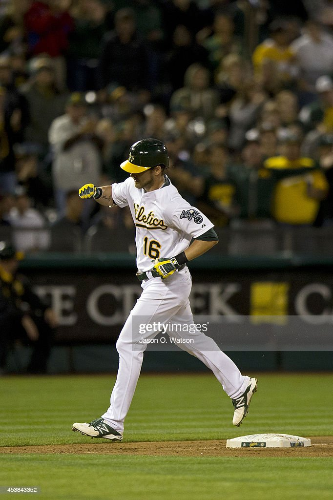 <a gi-track='captionPersonalityLinkClicked' href=/galleries/search?phrase=Josh+Reddick&family=editorial&specificpeople=5746348 ng-click='$event.stopPropagation()'>Josh Reddick</a> #16 of the Oakland Athletics rounds the bases after hitting a two run home run off of Gonzalez Germen (not pictured) of the New York Mets during the eighth inning of an interleague game at O.co Coliseum on August 19, 2014 in Oakland, California. The Oakland Athletics defeated the New York Mets 6-2.