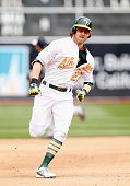 Josh Reddick of the Oakland Athletics runs to third base against the Detroit Tigers at Oco Coliseum on May 25 2015 in Oakland California