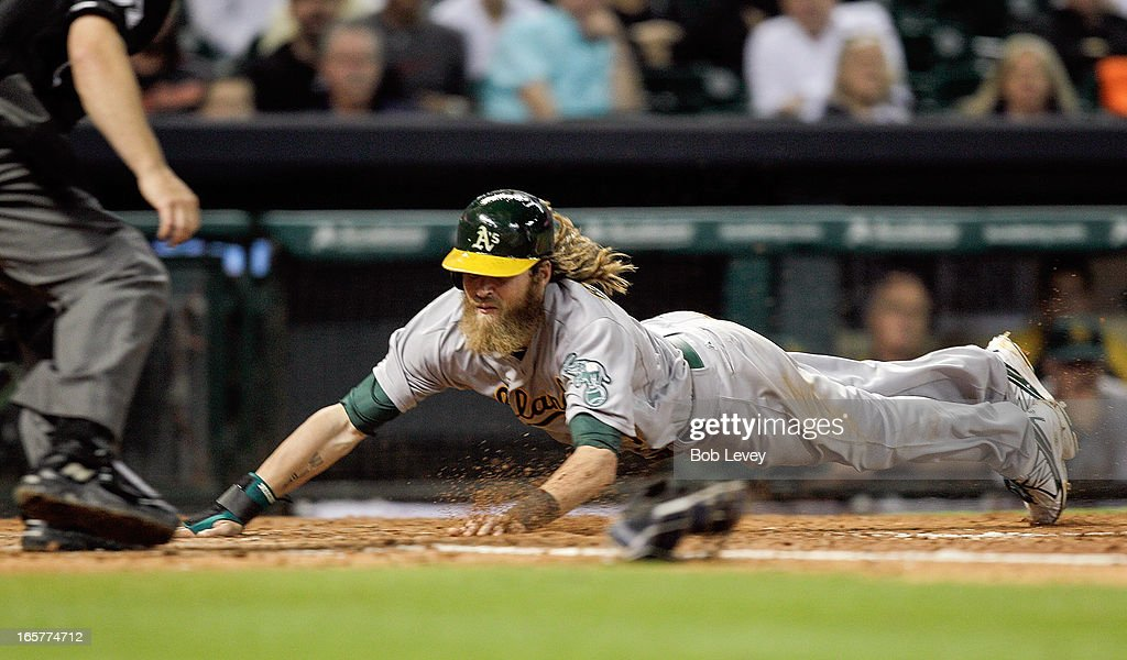 <a gi-track='captionPersonalityLinkClicked' href=/galleries/search?phrase=Josh+Reddick&family=editorial&specificpeople=5746348 ng-click='$event.stopPropagation()'>Josh Reddick</a> #16 of the Oakland Athletics scores on a sacrifice bunt by John Jaso #5 of the Oakland Athletics in the fifth inning against the Houston Astros at Minute Maid Park on April 5, 2013 in Houston, Texas.