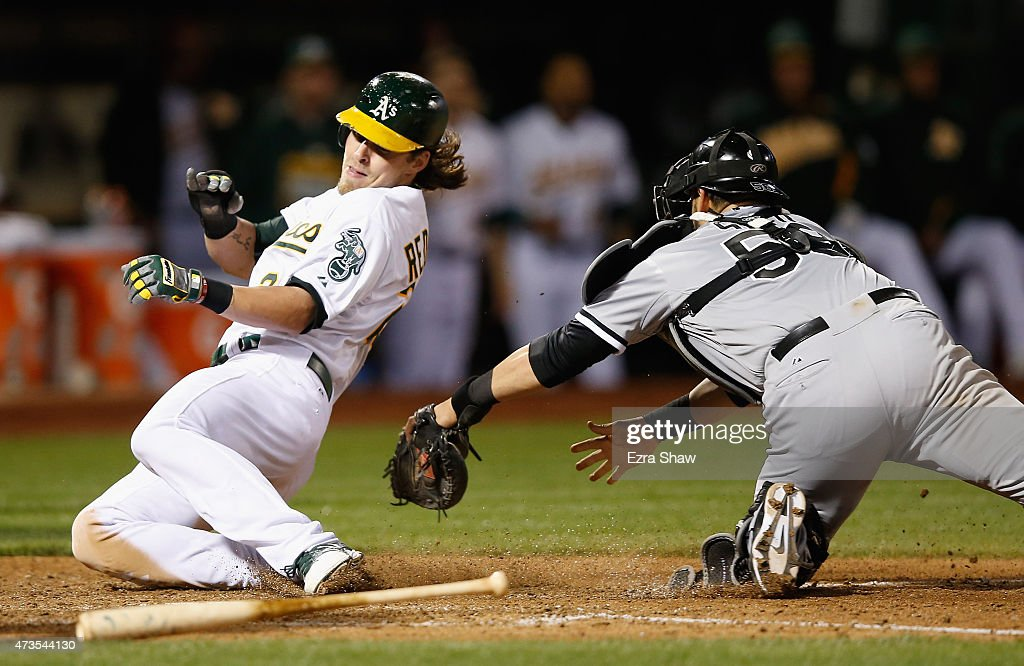 <a gi-track='captionPersonalityLinkClicked' href=/galleries/search?phrase=Josh+Reddick&family=editorial&specificpeople=5746348 ng-click='$event.stopPropagation()'>Josh Reddick</a> #22 of the Oakland Athletics slides safely past <a gi-track='captionPersonalityLinkClicked' href=/galleries/search?phrase=Geovany+Soto&family=editorial&specificpeople=743668 ng-click='$event.stopPropagation()'>Geovany Soto</a> #58 of the Chicago White Sox to score on a hit by Billy Butler #16 in the sixth inning at O.co Coliseum on May 15, 2015 in Oakland, California.