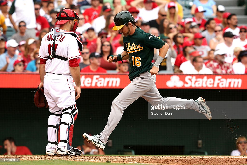 <a gi-track='captionPersonalityLinkClicked' href=/galleries/search?phrase=Josh+Reddick&family=editorial&specificpeople=5746348 ng-click='$event.stopPropagation()'>Josh Reddick</a> #16 of the Oakland Athletics sores a run after stealing third then advancing on a throwing error by catcher <a gi-track='captionPersonalityLinkClicked' href=/galleries/search?phrase=Chris+Iannetta&family=editorial&specificpeople=836137 ng-click='$event.stopPropagation()'>Chris Iannetta</a> #17 of the Los Angeles Angels of Anaheim at Angel Stadium of Anaheim on July 21, 2013 in Anaheim, California.