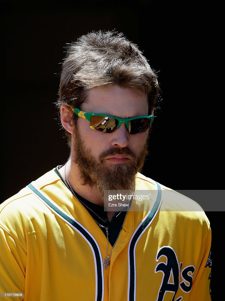 <a gi-track='captionPersonalityLinkClicked' href=/galleries/search?phrase=Josh+Reddick&family=editorial&specificpeople=5746348 ng-click='$event.stopPropagation()'>Josh Reddick</a> #16 of the Oakland Athletics stands in the dugout during their game against the New York Yankees at O.co Coliseum on June 13, 2013 in Oakland, California.