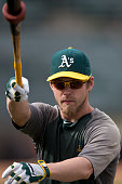 Josh Reddick of the Oakland Athletics swings a bat during batting practice before the game against the New York Yankees at Oco Coliseum on June 14...