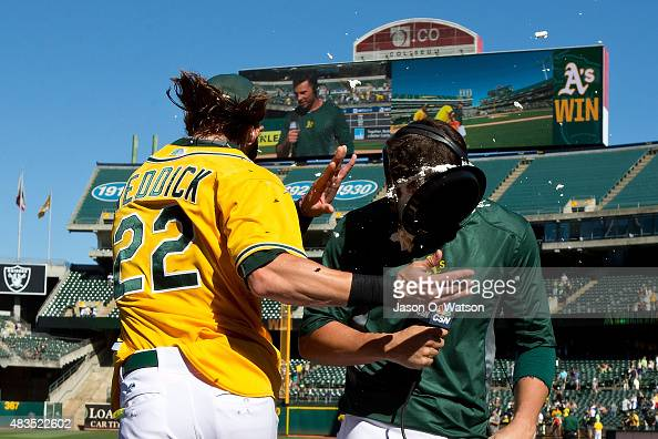 Josh Reddick of the Oakland Athletics throws a pie in the face of Danny Valencia after the game against the Houston Astros at Oco Coliseum on August...
