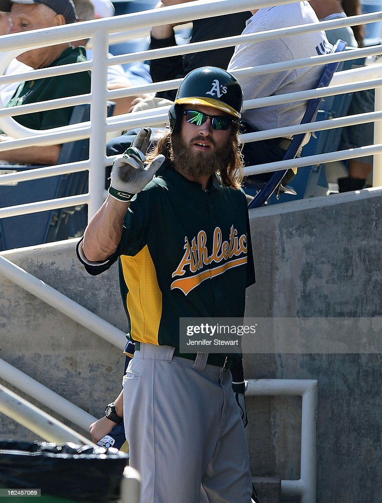 Josh Reddick #16 of the Oakland Athletics walks back to the dugout after striking out against the Milwaukee Brewers during the spring training game at Maryvale Baseball Park on February 23, 2013 in Phoenix, Arizona.