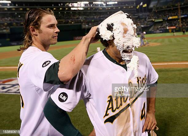 Josh Reddick puts a cream pie on the face of Coco Crisp of the Oakland Athletics after Crisp hit a gamewinning single to beat the Detroit Tigers in...