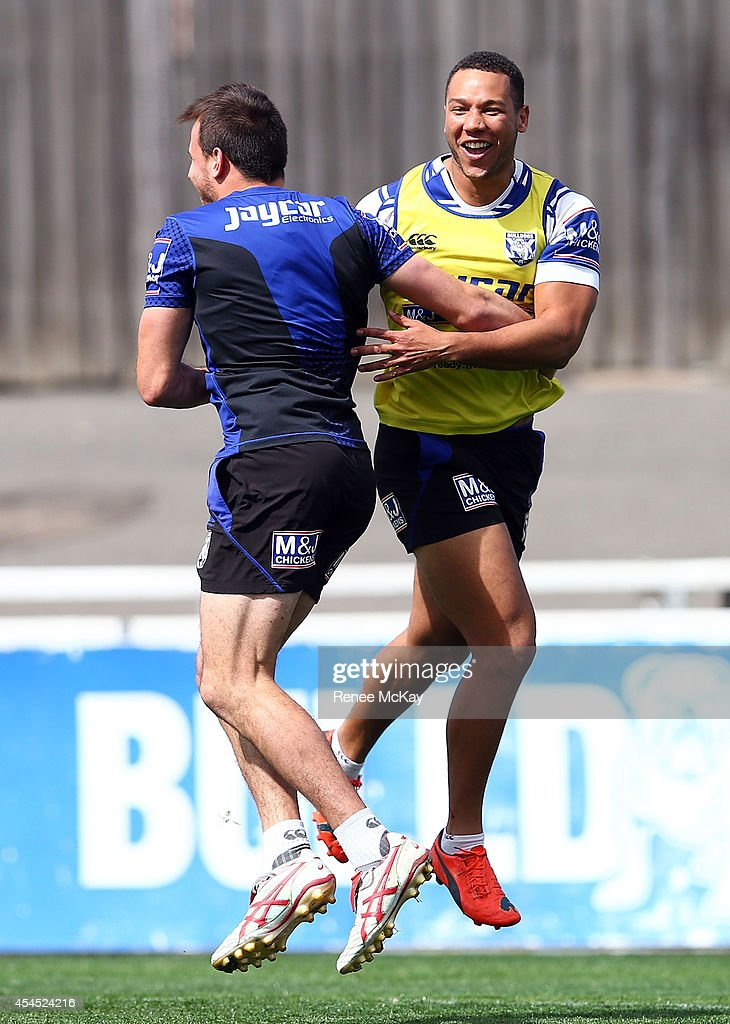Josh Reynolds and Moses Mbye celebrate during a Canterbury Bulldogs NRL training session at Belmore Sports Ground on September 3, 2014 in Sydney, Australia.
