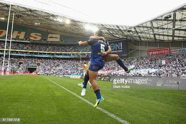 Josh Reynolds and Sam Perrett of the Bulldogs celebrate Sam Perrett scoring a try during the round four NRL match between the South Sydney Rabbitohs...