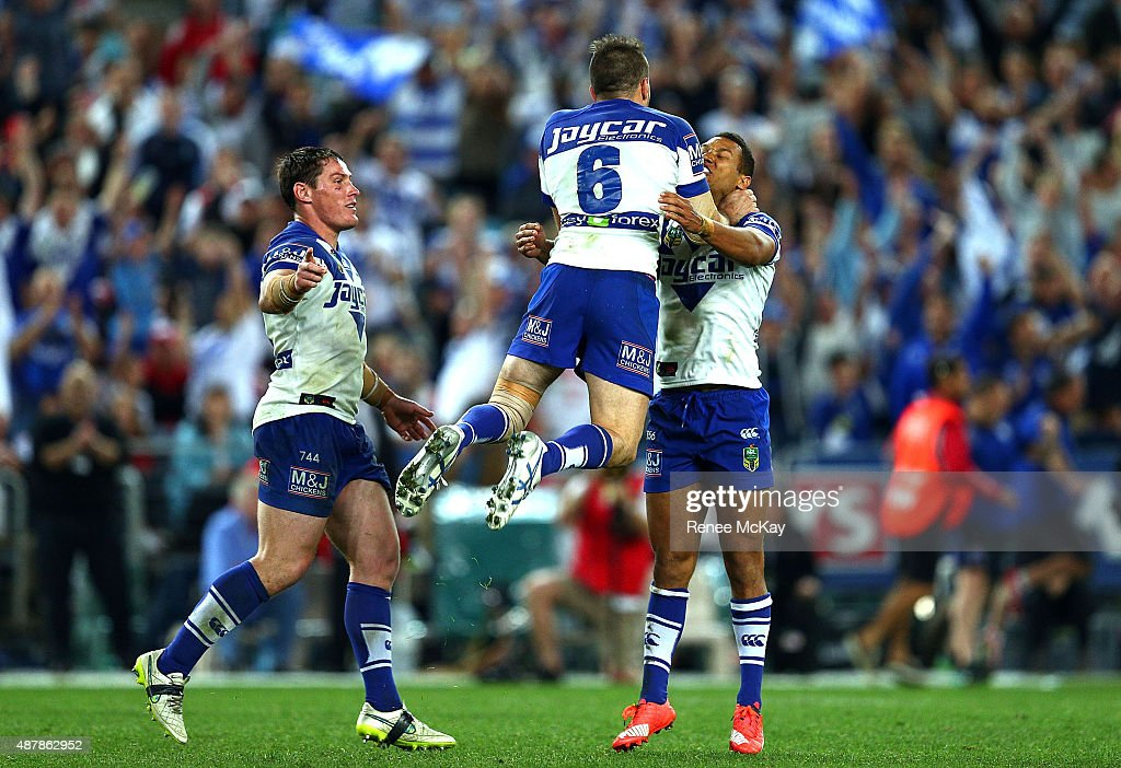 Josh Reynolds celebrates his winning field goal with Josh Jackson and Moses Mbye during the NRL Elimination Final match between the Canterbury Bulldogs and the St George Illawarra Dragons at ANZ Stadium on September 12, 2015 in Sydney, Australia.