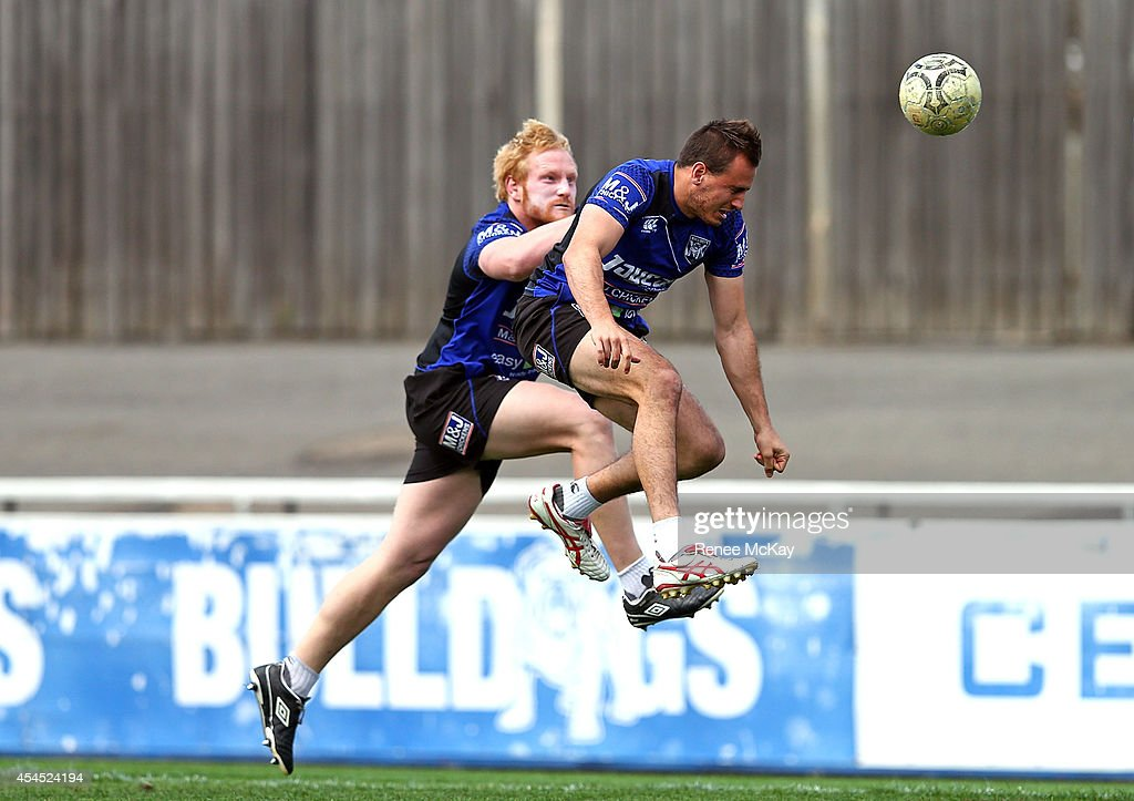 Josh Reynolds gets to the ball ahead of <a gi-track='captionPersonalityLinkClicked' href=/galleries/search?phrase=James+Graham+-+Rugby+Player&family=editorial&specificpeople=15021163 ng-click='$event.stopPropagation()'>James Graham</a> during a Canterbury Bulldogs NRL training session at Belmore Sports Ground on September 3, 2014 in Sydney, Australia.