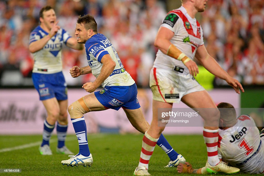 Josh Reynolds of the Bulldogs celebrates kicking a field goal to win the match during the NRL Elimination Final match between the Canterbury Bulldogs and the St George Illawarra Dragons at ANZ Stadium on September 12, 2015 in Sydney, Australia.