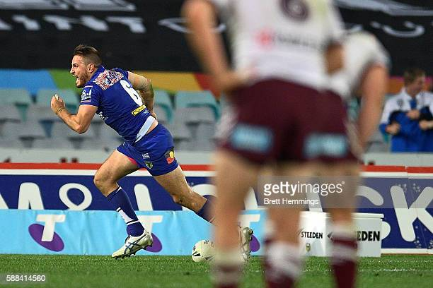 Josh Reynolds of the Bulldogs celebrates scoring a try to win the match during the round 23 NRL match between the Canterbury Bulldogs and the Manly...