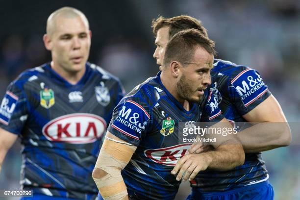 Josh Reynolds of the Bulldogs gets up slowly after a tackle during the round nine NRL match between the Canterbury Bulldogs and the Canberra Raiders...