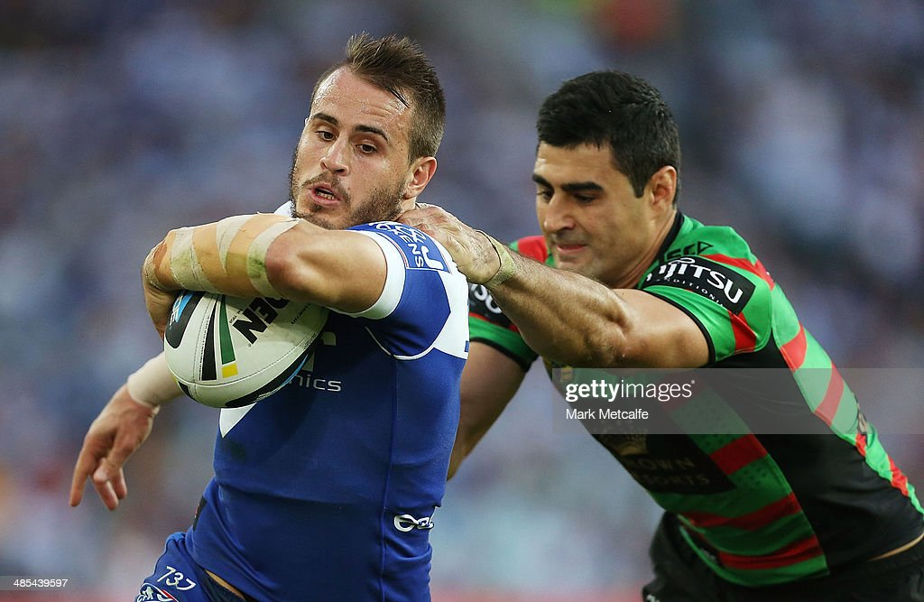 Josh Reynolds of the Bulldogs is tackled by <a gi-track='captionPersonalityLinkClicked' href=/galleries/search?phrase=Bryson+Goodwin&family=editorial&specificpeople=5036344 ng-click='$event.stopPropagation()'>Bryson Goodwin</a> of the Rabbitohs during the round seven NRL match between the South Sydney Rabbitohs and the Canterbury-Bankstown Bulldogs at ANZ Stadium on April 18, 2014 in Sydney, Australia.
