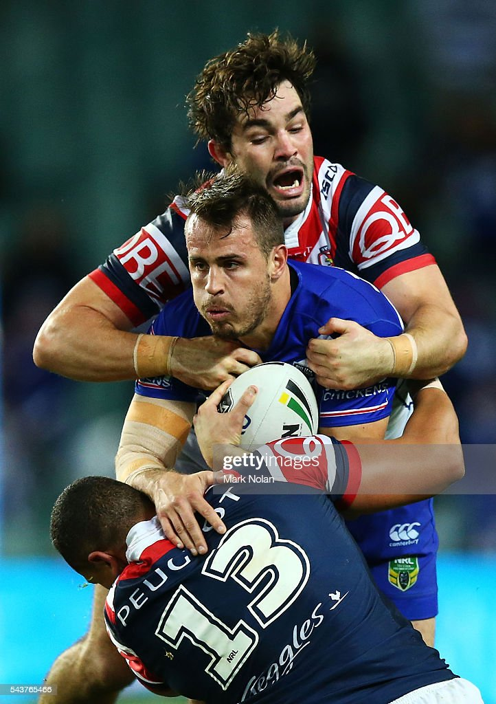 <a gi-track='captionPersonalityLinkClicked' href=/galleries/search?phrase=Josh+Reynolds+-+Rugby+Player&family=editorial&specificpeople=11188738 ng-click='$event.stopPropagation()'>Josh Reynolds</a> of the Bulldogs is tackled during the round 17 NRL match between the Sydney Roosters and the Canterbury Bulldogs at Allianz Stadium on June 30, 2016 in Sydney, Australia.