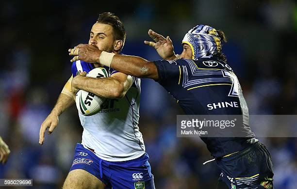 Josh Reynolds of the Bulldogs is tackled during the round 25 NRL match between the Canterbury Bulldogs and the North Queensland Cowboys at Belmore...