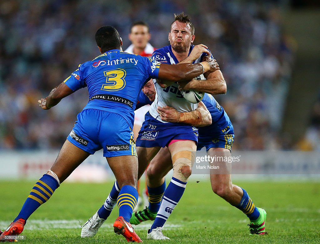 Josh Reynolds of the Bulldogs is tackled during the round nine NRL match between the Parramatta Eels and the Canterbury Bulldogs at ANZ Stadium on April 29, 2016 in Sydney, Australia.