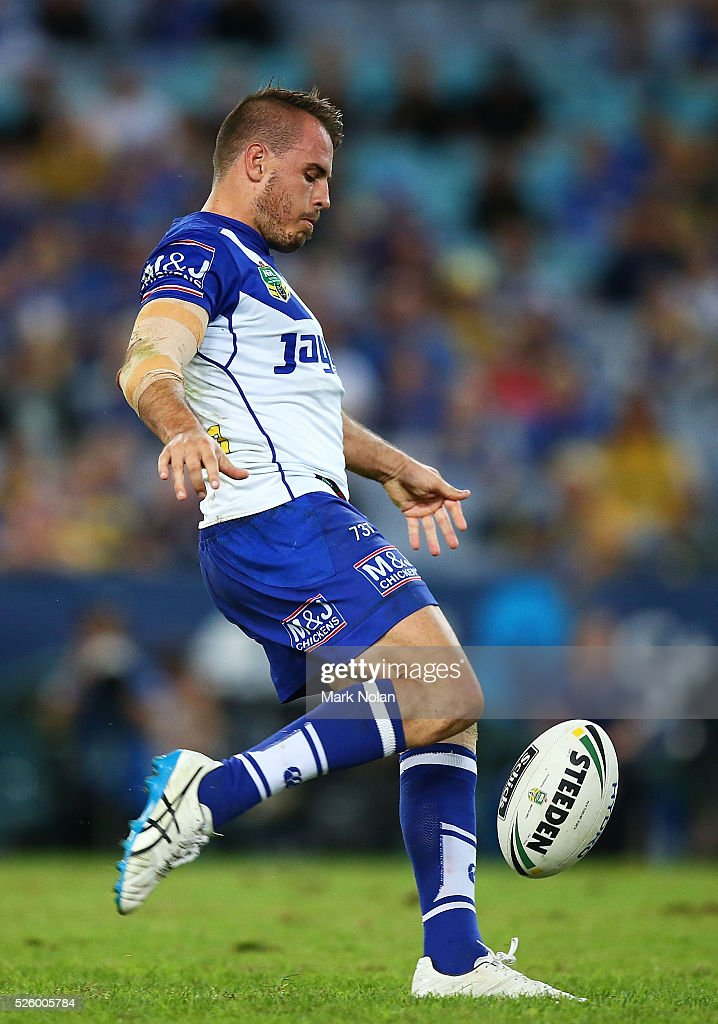 Josh Reynolds of the Bulldogs kicks ahead during the round nine NRL match between the Parramatta Eels and the Canterbury Bulldogs at ANZ Stadium on April 29, 2016 in Sydney, Australia.