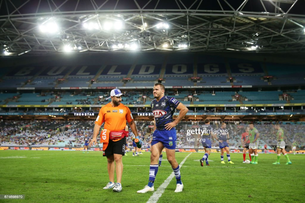 Josh Reynolds of the Bulldogs leaves the field with an injury during the round nine NRL match between the Canterbury Bulldogs and the Canberra Raiders at ANZ Stadium on April 29, 2017 in Sydney, Australia.