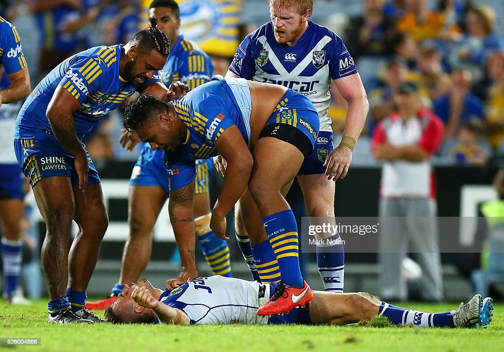 <a gi-track='captionPersonalityLinkClicked' href=/galleries/search?phrase=Josh+Reynolds+-+Rugby+Player&family=editorial&specificpeople=11188738 ng-click='$event.stopPropagation()'>Josh Reynolds</a> of the Bulldogs lies on the ground after a tackle during the round nine NRL match between the Parramatta Eels and the Canterbury Bulldogs at ANZ Stadium on April 29, 2016 in Sydney, Australia.