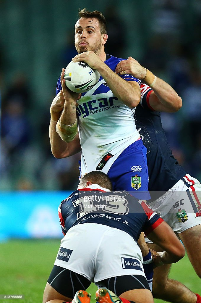 <a gi-track='captionPersonalityLinkClicked' href=/galleries/search?phrase=Josh+Reynolds+-+Rugby+Player&family=editorial&specificpeople=11188738 ng-click='$event.stopPropagation()'>Josh Reynolds</a> of the Bulldogs looks to offload during the round 17 NRL match between the Sydney Roosters and the Canterbury Bulldogs at Allianz Stadium on June 30, 2016 in Sydney, Australia.